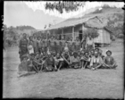 group of men, some Armed Native Constabulary in uniform, posed outside barracks (?) (see also RAI No. 34405)
