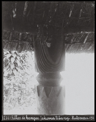 carved wooden pillar supporting roof