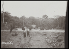 porters (?) and hut on riverbank, seen from on board steamer ?