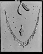 jewellery; necklace of amulets and silver cross