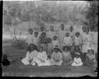 group of men, women and children, including Rarotongan children of LMS South Seas techers, all wearing European clothing, in grounds of London Missionary Society Mission House