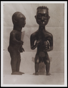 2 standing male figurines, 1 holding a head