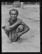 Curly-haired man from village of Ban-Sai Kau.