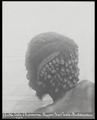 back of mans head showing elaborately plaited hair