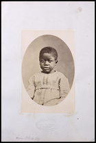 Photograph of small ?African boy in Tunic facing front