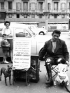 Barrel organ player in Marseille, 1963 (b/w photo)