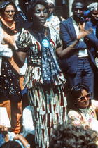 African woman, arms outspread, and shouting, Nairobi, 1985. International Women's Tribune Centre Slide Show, NGO Forum, Nairobi