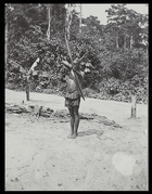 man holding bow and arrow pointed at camera