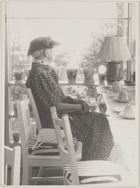 Photograph of Frances Borrow with rows of pots and teacups