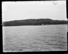 Distant view of government station at Samarai (?), taken from aboard ship