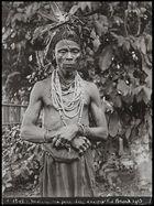 man wearing feather headdress