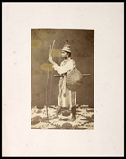 man with long hair tied back, wearing hat with feather, holding a bow and arrow