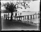 Group of people on the jetty at Delena with the government boat