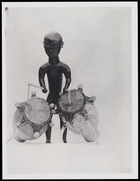 1 figurine playing 2 drums