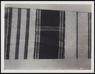 3 textile pieces, 2 woven in stripes and 1 with solid colour block with cross stripes