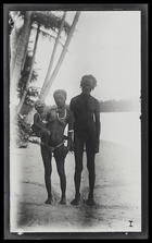 An old man standing next to his wife, who is holding a baby; full face, on Kulumbangra Island, a large volcanic island near Gizo.