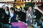 Asian Women Dancing With Hands in Air. International Women's Tribune Centre Slide Show, NGO Forum, Huairou, China 30 August – 8 September, 1995