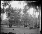 wooden framework of large men's house under construction