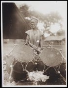 1 male playing 2 drums