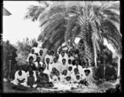 Large group of men and women Rarotongan (?) teachers and pastors of the London Missionary Society with their children, and converts (?)