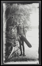 An old man of the West (who dared not approach closer because of a taboo against his village) with a shield and axe, on on Kulumbangra Island, a large volcanic island near Gizo.