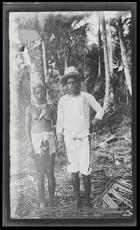 A man from a bush village on Kulumbangra Island, a large volcanic island near Gizo, standing next to his wife.