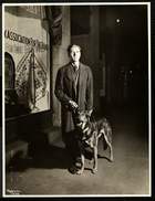 Blind man and his guide dog on the sidewalk in front of the New York Association for the Blind, 111 East 59th Street, New York, 1938 (silver gelatin print)