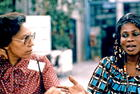 Peggy Antrobus (Barbados) (left) talking with Fanny Dontoh Russell (Ghana) (right), Copenhagen, 1980. International Women's Tribune Centre Slide Show, NGO Forum, Copenhagen