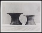 2 spool shaped metal vases