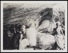 3 males inside a cave