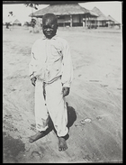 young boy, Torday's servant called Buya, dressed in European style shirt and trousers