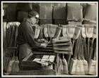 Blind man labeling brooms at the Bourne Memorial Building, New York, 1935 (silver gelatin print)