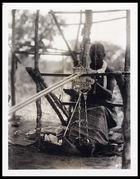 Weaver at work; note treadles between the toes, figure 120