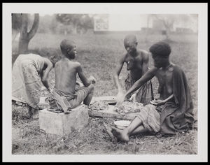1 4 seated females working clay